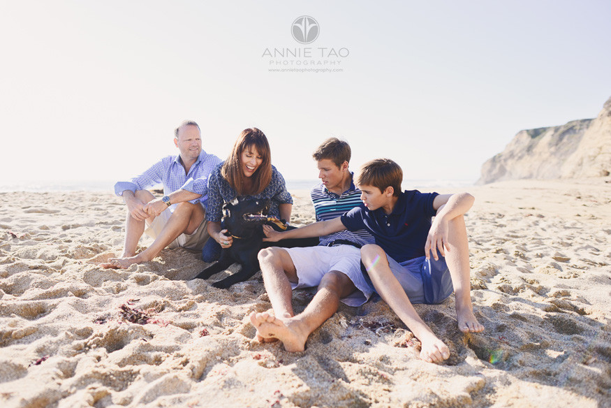 Bay-Area-lifestyle-family-photography-family-sitting-on-beach-with-dog