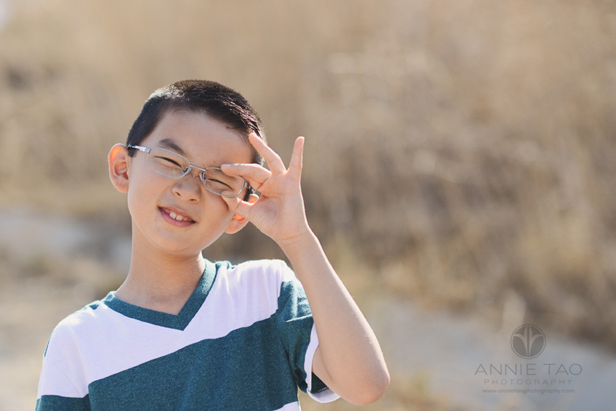 East-Bay-lifestyle-children-photography-young-boy-fixing-glasses