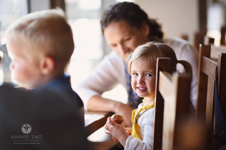San-Francisco-lifestyle-children-photography-toddler-girl-smiling-while-eating-a-donut