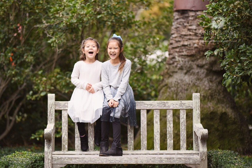 San-Francisco-lifestyle-children-photography-two-sisters-standing-on-bench-and-laughing-together