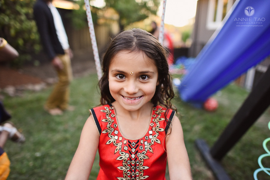 East-Bay-event-photography-diwali-young-girl-on-swing-in-backyard