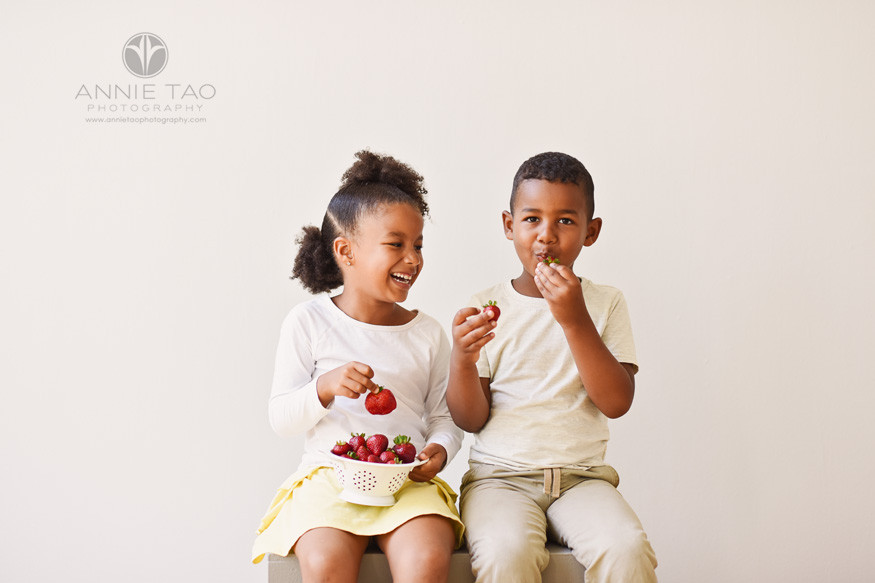 East-Bay-commercial-photography-sister-laughing-while-brother-eats-strawberries