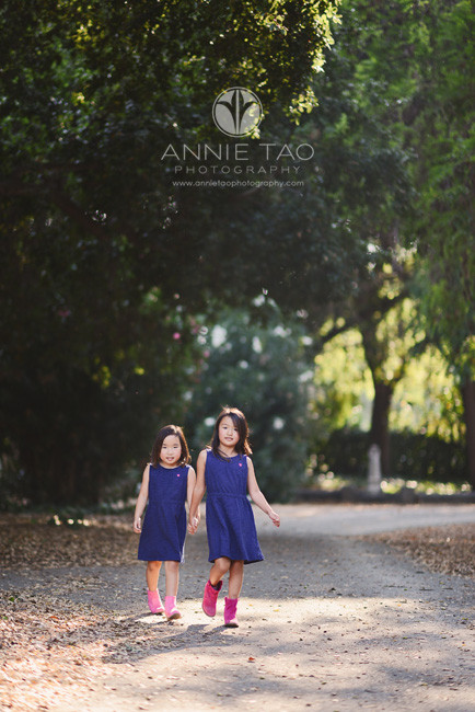 East-Bay-children-lifestyle-photography-two-sisters-holding-hands-walking-forward