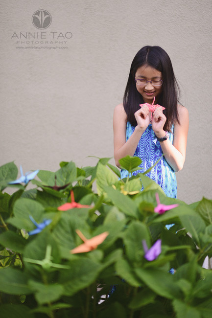 East-Bay-lifestyle-preteen-photography-girl-making-a-wish-with-origami-crane