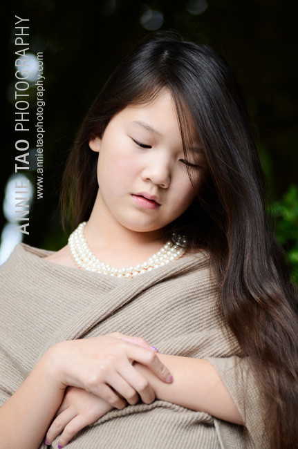 Preteen-model-styled-photography-dressed-in-beige-looking-down