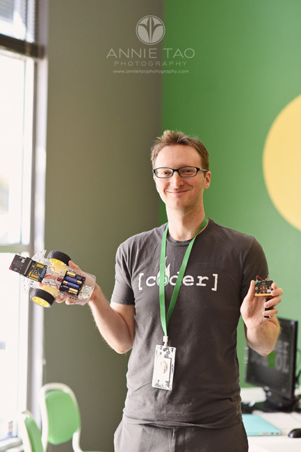 South-Bay-commercial-photography-coding-teacher-holding-robot-and-controller
