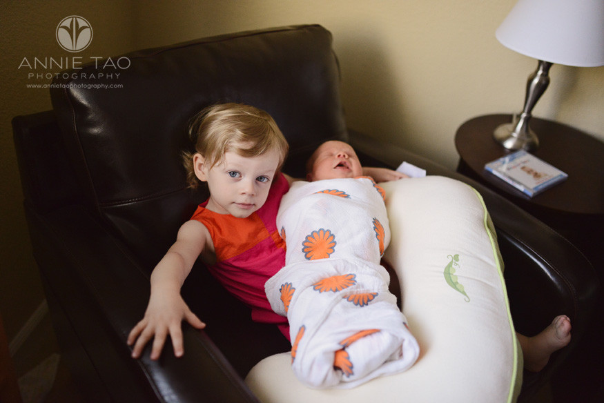 East-Bay-lifestyle-newborn-photography-toddler-girl-relaxing-with-her-newborn-sister