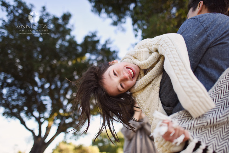 San-Francisco-bay-area-lifestyle-family-photography-young-girl-hanging-upside-down-on-dads-arms