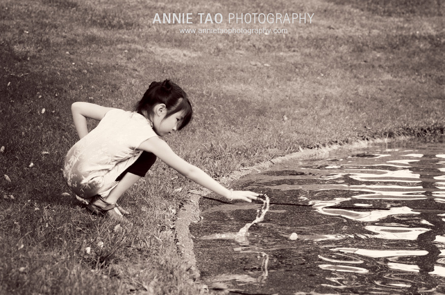 San-Francisco-Bay-Area-child-model-photography-Asian-doll-touching-leaves-at-lake