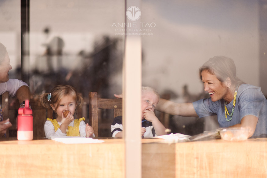 San-Francisco-lifestyle-family-photography-mother-smiling-at-her-children-through-window