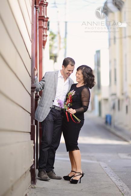 San-Francisco-lifestyle-engagement-photography-couple-laughing-on-sidewalk