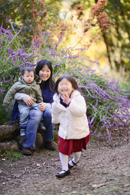 Bay-Area-lifestyle-family-photography-young-girl-laughing-and-running-away-with-mom-and-baby-brother-watching