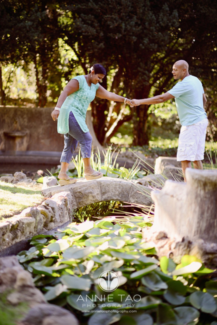 Bay-Area-lifestyle-photography-man-helping-his-wife-across-small-bridge