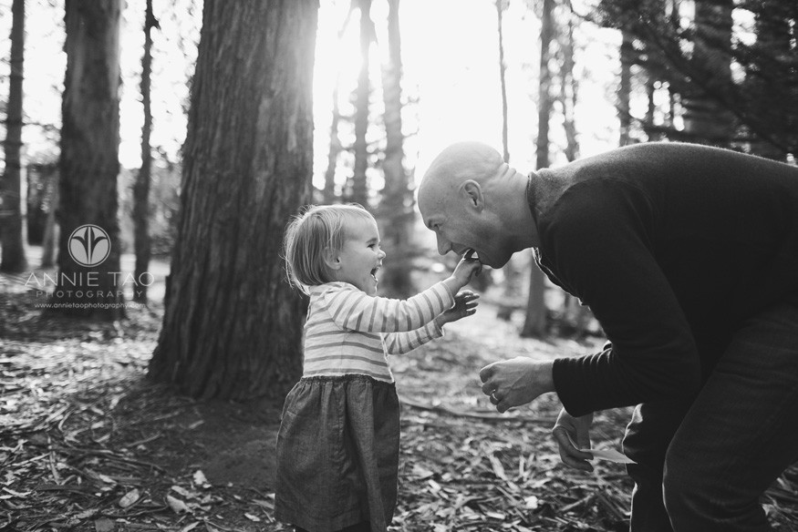 San-Francisco-lifestyle-family-photography-preschooler-girl-putting-finger-in-dads-mouth-BxW