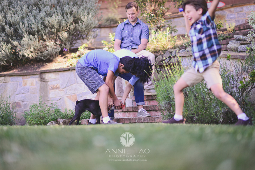 South-Bay-lifestyle-family-photography-family-playing-badminton-and-dog-steals-the-shuttlecock