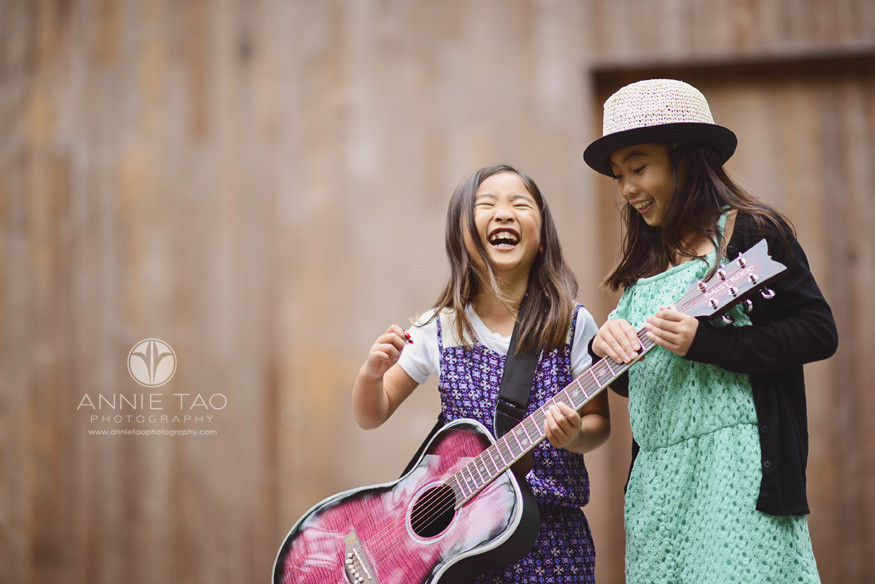 San-Francisco-lifestyle-children-photography-laughing-sisters-with-pink-guitar-2