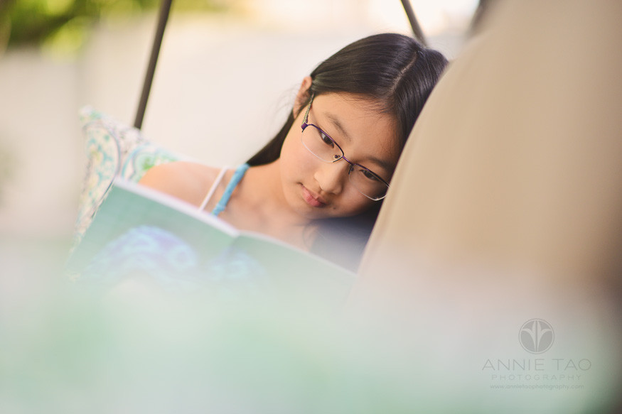 East-Bay-lifestyle-preteen-photography-girl-reading-on-swing-bench