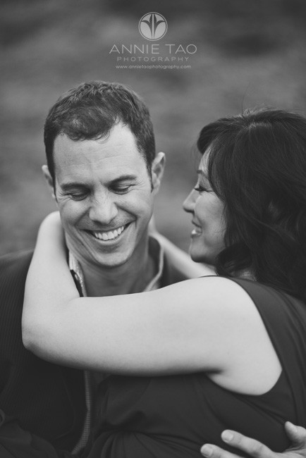 San-Francisco-lifestyle-engagement-photography-mans-reaction-to-his-fiancee-sitting-on-his-lap-BxW