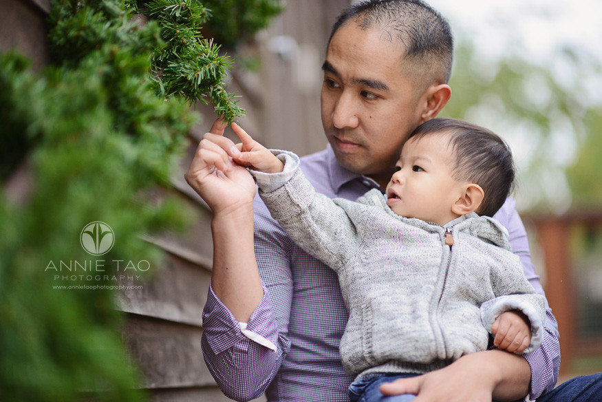 East-Bay-lifestyle-family-photography-father-and-toddler-son-looking-at-garland