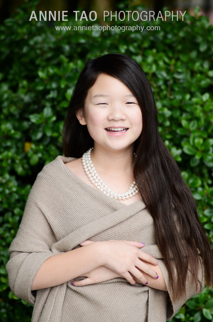 Preteen-model-styled-photography-dressed-in-beige-smiling-at-me