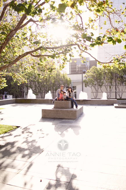 San-Francisco-lifestyle-family-photography-family-sitting-on-cement-structure-in-city