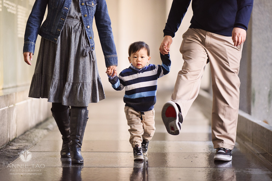 san-francisco-lifestyle-family-photography-parents-holding-toddler-sons-hands-while-walking-behind-waterfall-closeup