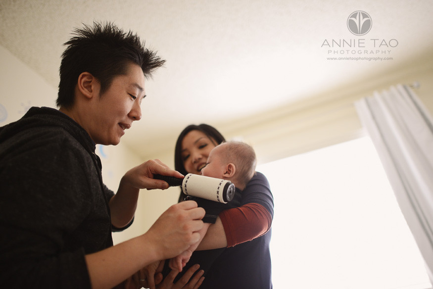 South-Bay-lifestyle-baby-photography-father-sticky-rolling-his-baby