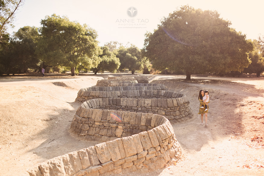 Bay-Area-lifestyle-family-photography-woman-carrying-toddler-daughter-near-snake-art