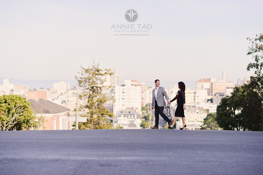 San-Francisco-lifestyle-couple-photography-man-holding-hands-with-fiancee-on-top-of-hill