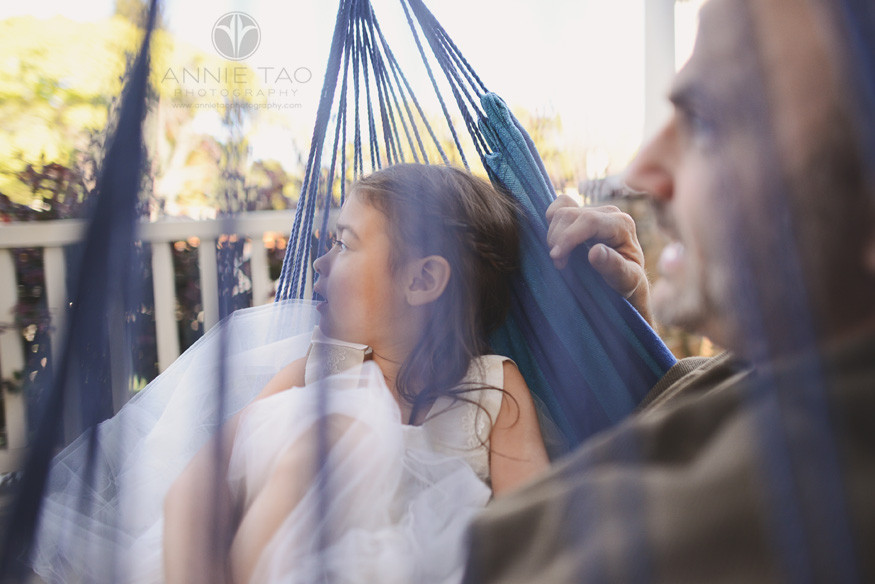 East-Bay-lifestyle-family-photography-father-and-daughter-sitting-on-swing-seen-through-rope