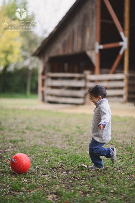 East-Bay-lifestyle-children-photography-boy-running-to-kick-red-ball