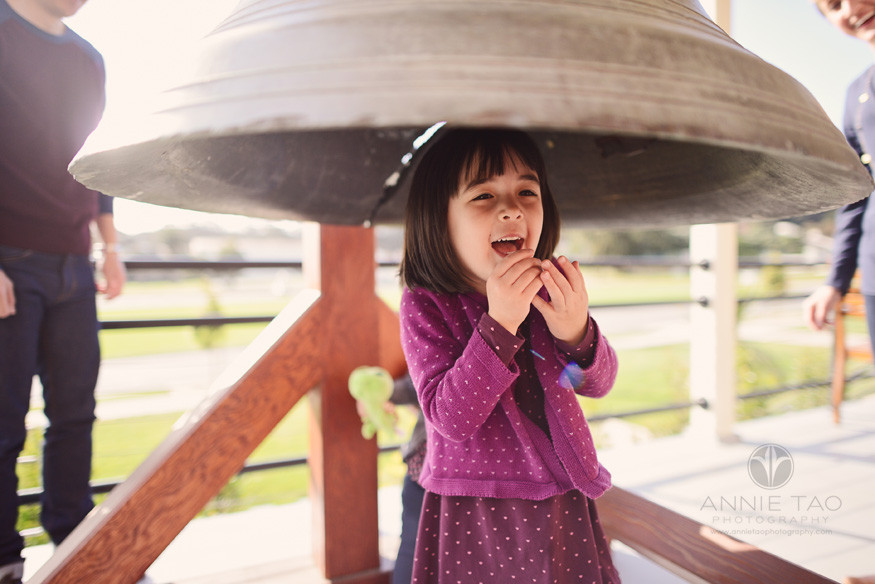 San-Francisco-lifestyle-children-photography-young-girl-giggling-under-giant-bell