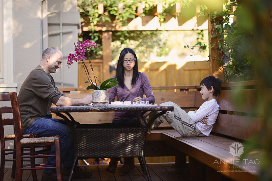 East-Bay-lifestyle-family-photography-playing-dominos-on-patio-table