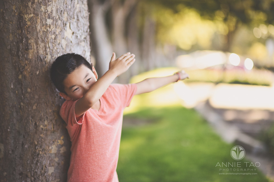 East-Bay-lifestyle-children-photography-boy-dabbing-by-tree