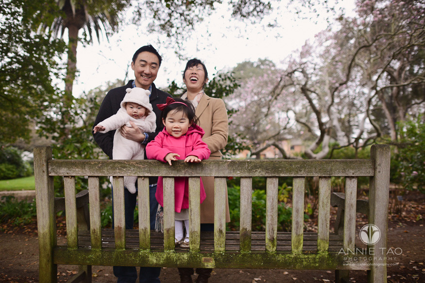 Bay-Area-Palo-Alto-lifestyle-family-photography-family-facing-back-of-bench-woman-laughs