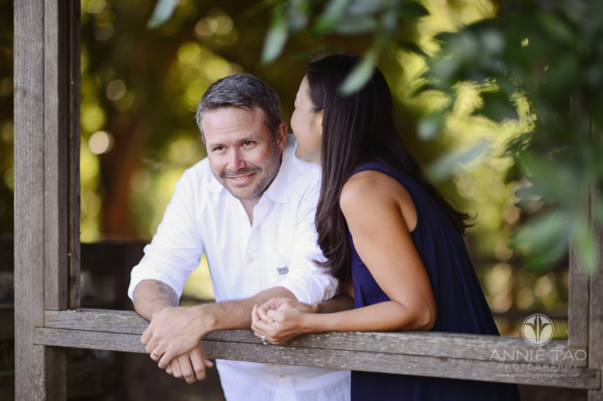 East-Bay-lifestyle-couple-photography-woman-whispering-to-husband