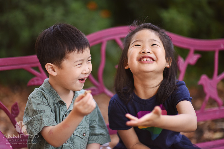 Bay-Area-lifestyle-children-photography-young-siblings-sitting-on-fuscia-bench-and-laughing