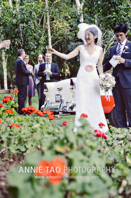 Los-Altos-Wedding-Photography-cocktail-hour-bride-toasting-guest-in-front-of-antique-car