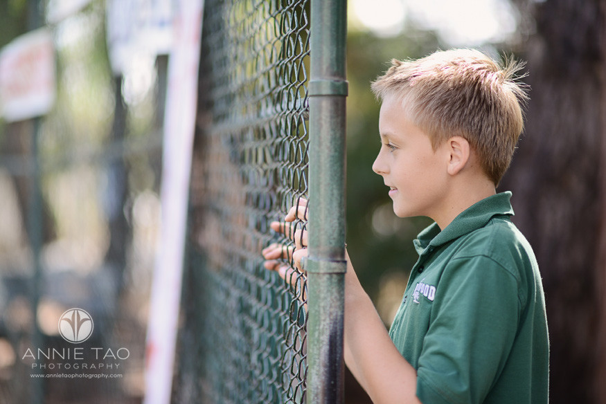 Bay-Area-Los-Altos-Commercial-Photography-student-watching-game-from-behind-the-fence