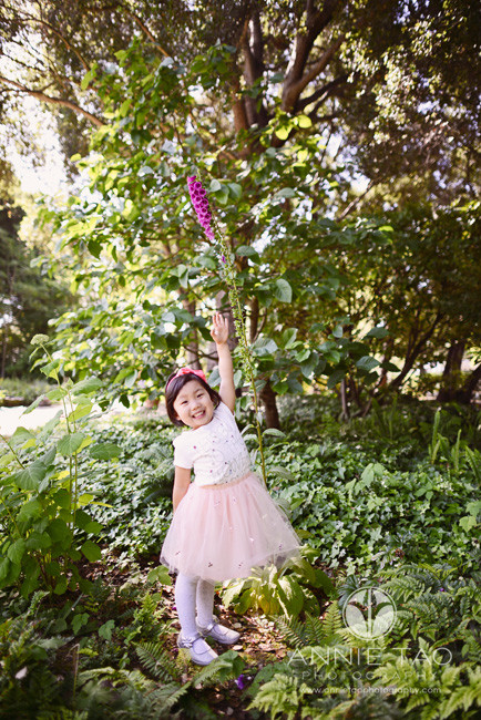 Bay-Area-lifestyle-children-photography-three-year-old-girl-reaching-tall-by-flower