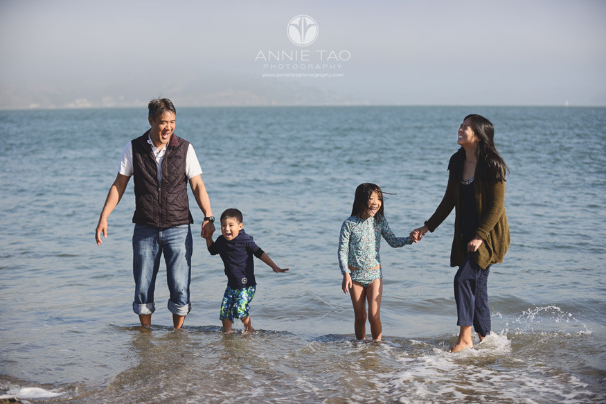 san-francisco-lifestyle-family-photography-parents-and-children-in-cold-water-at-beach