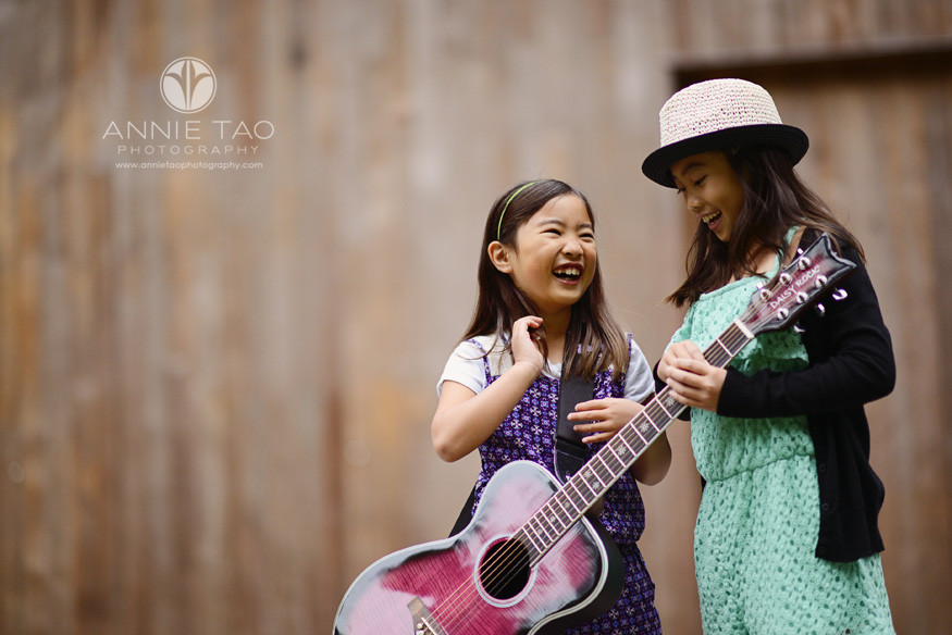 San-Francisco-lifestyle-children-photography-laughing-sisters-with-pink-guitar