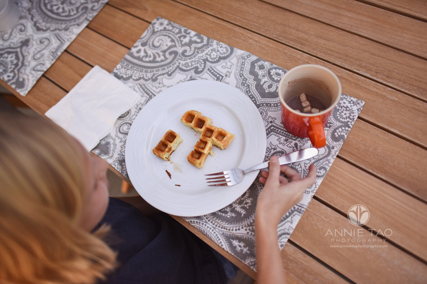 Bay-Area-lifestyle-children-photography-girl-eating-waffle-into-pi-pattern-plate-view