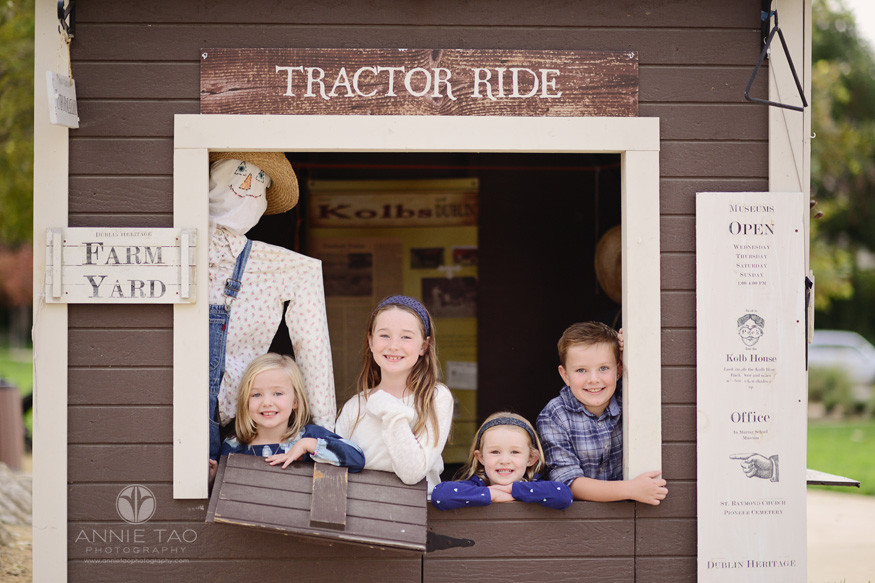 east-bay-lifestyle-children-photography-four-young-children-working-the-ticket-booth-at-farm