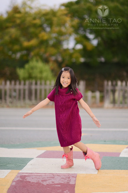Los-Altos-lifestyle-children-photography-young-girl-dancing-on-colorful-playground