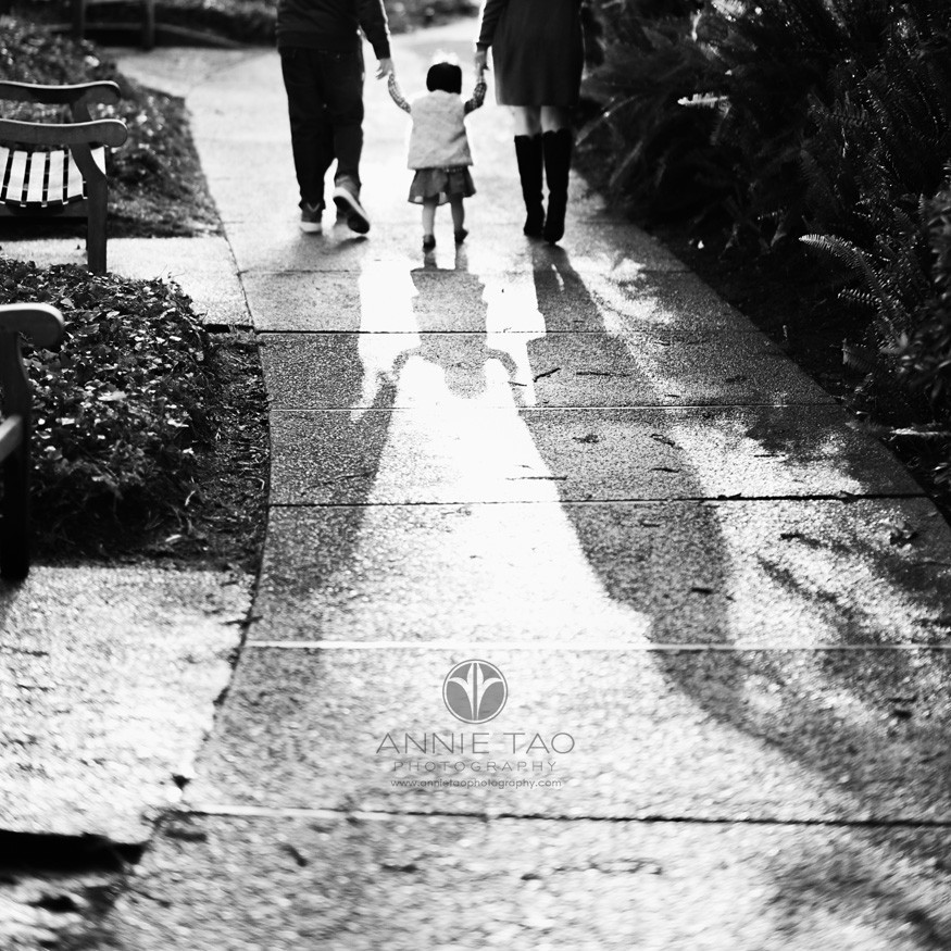 East-Bay-lifestyle-family-photography-family-holding-hands-while-walking-away-shadow-BxW