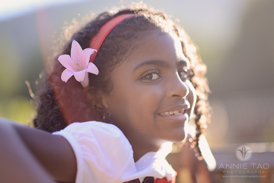 Bay-Area-Los-Altos-lifestyle-children-photography-young-girl-leaning-back-with-the-golden-hour-rays