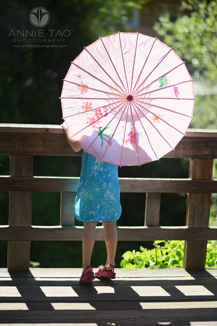 East-Bay-lifestyle-children-photography-young-girl-facing-away-with-pink-umbrella