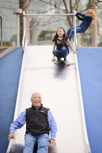 San-Francisco-lifestyle-family-photography-grandfather-going-down-slide