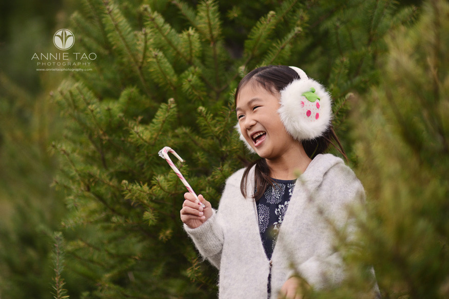 bay-area-lifestyle-photography-young-girl-with-earmuffs-and-candycane-tree-farm